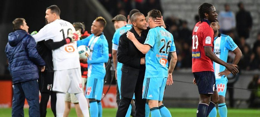 Lille coach Franck Passi, who used to be coach of Marseille, greets Florian Thauvin of Marseille  after the Ligue 1 match between Lille OSC and Olympique de Marseille at Stade Pierre Mauroy on March 17, 2017 in Lille, France. (Photo by Dave Winter/Icon Sport)