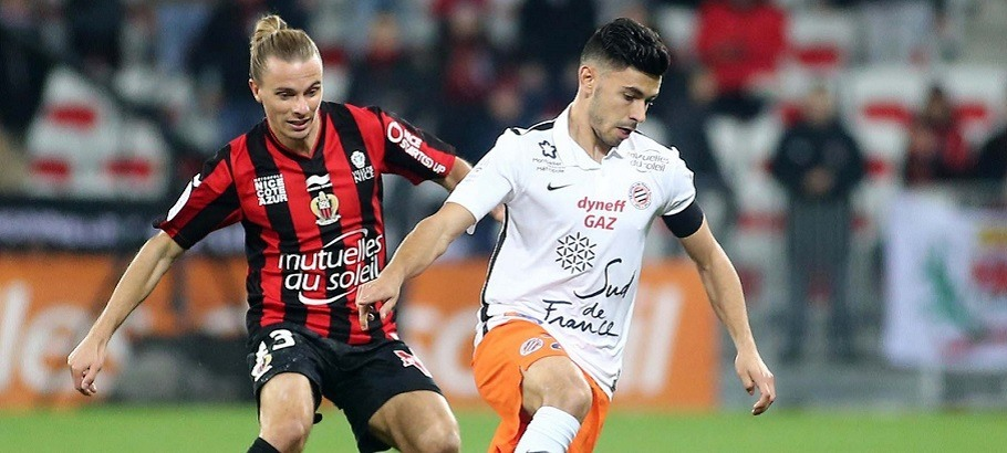 Niklas Hult / Morgan Sanson - 18.12.2015 - Nice / Montpellier - 19eme journee de Ligue 1 Photo : Serge Haouzi / Icon Sport